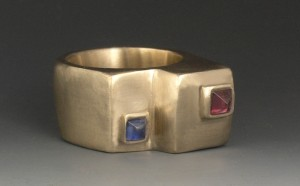 Hollow ring with inset natural garnet and sapphire