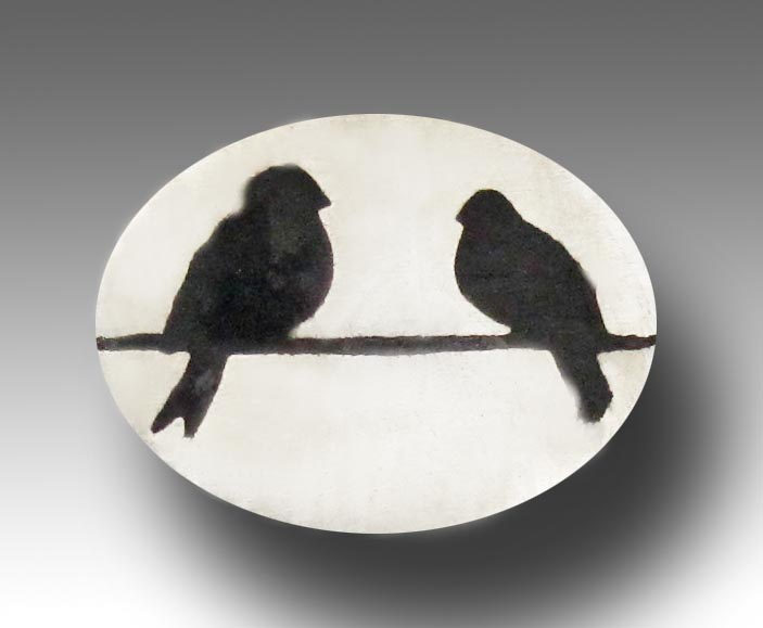 Two birds black on silver